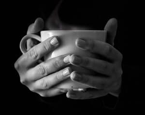 cup of hot coffee in hands